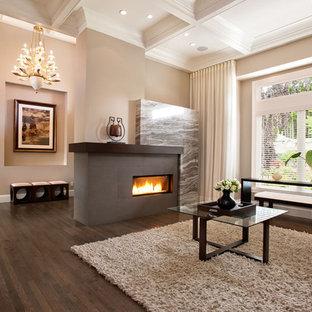 Diseño de salón para visitas cerrado, tradicional renovado, grande, sin televisor, con paredes beige, suelo de madera oscura, chimenea lineal y marco de chimenea de baldosas y/o azulejos