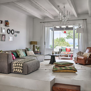 Medium sized eclectic formal open plan living room in Other with concrete flooring, no fireplace and grey walls.