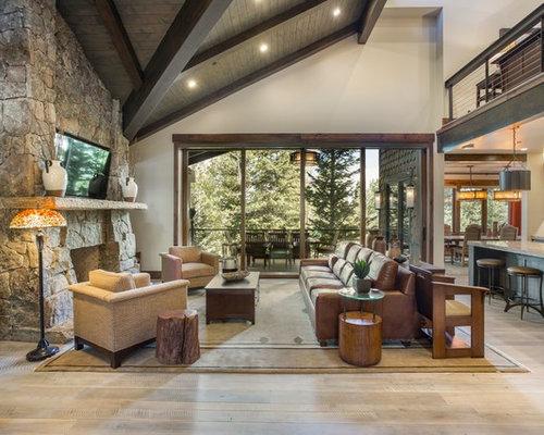 inspiration for a rustic open concept medium tone wood floor and brown floor living room remodel - Open Floor Plan Design Ideas