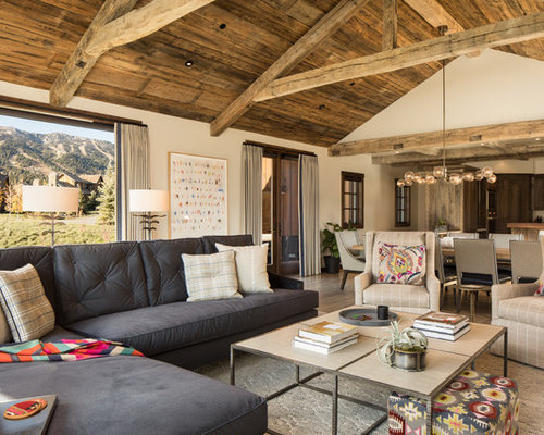 inspiration for a rustic open concept living room remodel in other with white walls - Open Floor Plan Design Ideas