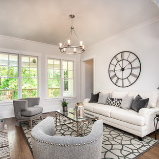 Design ideas for a classic formal enclosed living room in Atlanta with white walls, dark hardwood flooring, a standard fireplace and a brick fireplace surround.