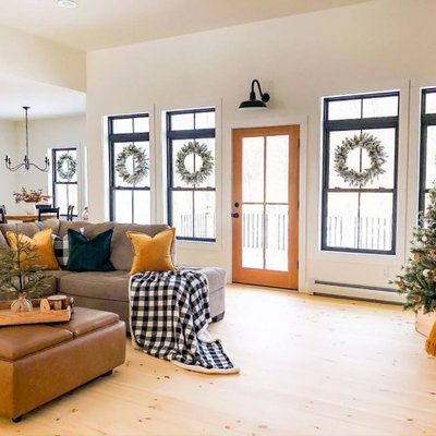 Large cottage open concept painted wood floor living room photo in Tampa with white walls, no fireplace and a media wall