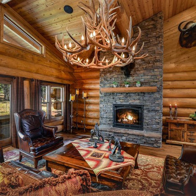 Living room - mid-sized rustic formal and open concept medium tone wood floor and brown floor living room idea in Phoenix with brown walls and a standard fireplace