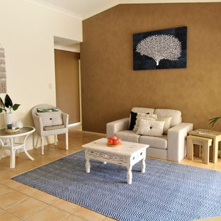 Design ideas for a beach style enclosed living room in Gold Coast - Tweed with brown walls and beige floor.