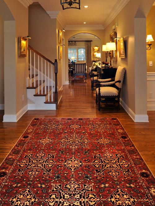 Mid Sized Elegant Formal And Enclosed Medium Tone Wood Floor Living Room Photo In Atlanta
