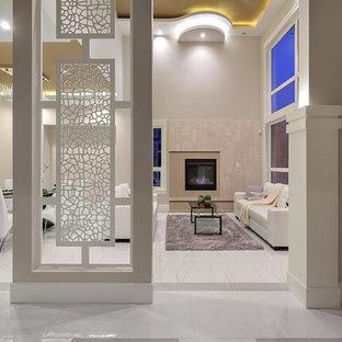 Ispirazione per un grande soggiorno design aperto con sala formale, pareti grigie, pavimento in marmo, camino classico, cornice del camino in legno e nessuna TV