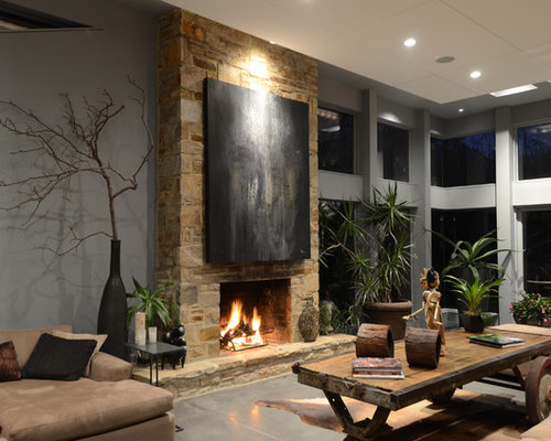 Example of a large trendy open concept concrete floor and gray floor living  room design in