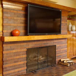 Inspiration for a medium sized midcentury enclosed living room in Chicago with brown walls, light hardwood flooring, a standard fireplace, a brick fireplace surround and a wall mounted tv.