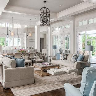 Idee per un grande soggiorno chic aperto con pareti bianche, parquet scuro, camino classico, cornice del camino in pietra e nessuna TV