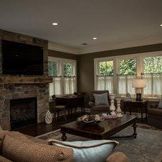 Farmhouse Living Room by Z+ Architects, LLC