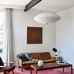 Inspiration for a midcentury living room in Melbourne with white walls, carpet, red floor, exposed beam and vaulted.