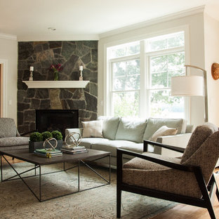 Living room - mid-sized coastal formal and enclosed medium tone wood floor and beige floor living room idea in Portland Maine with beige walls, a corner fireplace and a stone fireplace