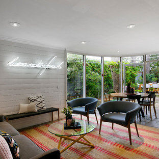 Photo of a transitional open concept living room in Sydney with white walls, no fireplace, no tv and grey floor.