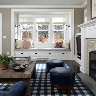 Example of a french country living room design in Minneapolis with gray walls, a standard fireplace and a brick fireplace