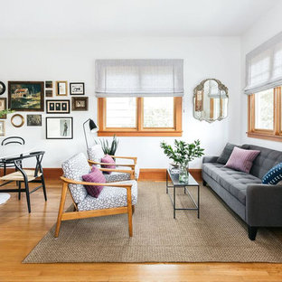Living room - mid-sized eclectic formal and open concept medium tone wood floor and brown floor living room idea in Seattle with white walls, no fireplace and no tv