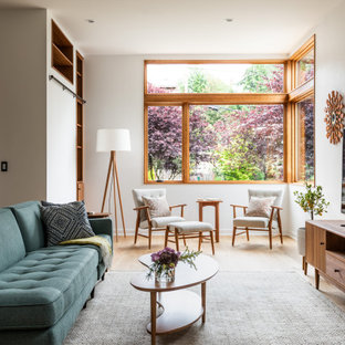 Living room - mid-sized contemporary open concept light wood floor and beige floor living room idea in Seattle with white walls and a tv stand
