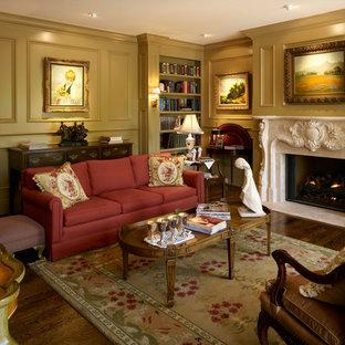 デンバーの中くらいのヴィクトリアン調のおしゃれな独立型リビング (フォーマル、ベージュの壁、濃色無垢フローリング、標準型暖炉、石材の暖炉まわり、テレビなし、茶色い床) の写真