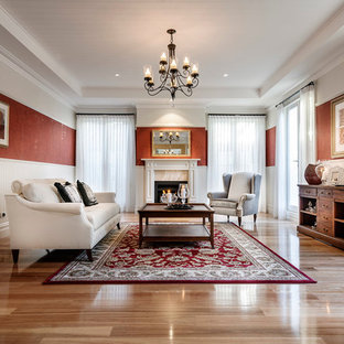 Design ideas for a traditional living room in Perth with red walls.