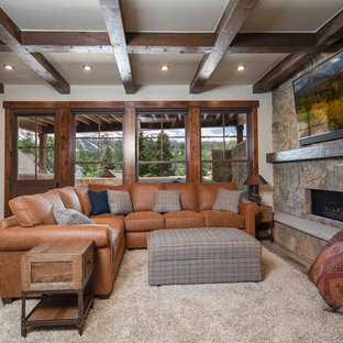 Photo of a rustic living room in Denver with white walls, a ribbon fireplace, a stone fireplace surround and a wall mounted tv.