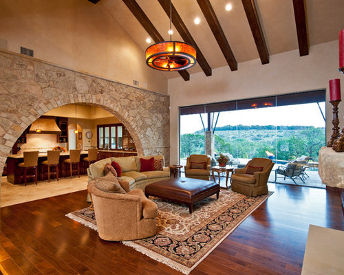 Example Of A Large Classic Living Room Design In Austin With Beige Walls
