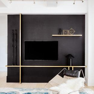 Foto di un grande soggiorno minimal stile loft con pareti nere, parquet chiaro, nessun camino e TV a parete