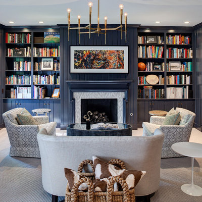 Example of a transitional carpeted living room library design in Chicago with blue walls, a standard fireplace, a tile fireplace and no tv