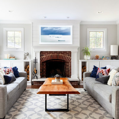 Inspiration for a mid-sized coastal formal living room remodel in Chicago with gray walls, a standard fireplace and a brick fireplace