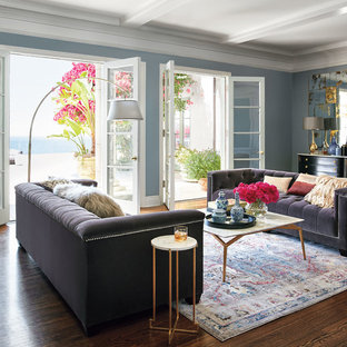 Example of a transitional formal and enclosed dark wood floor and brown floor living room design in Other with blue walls