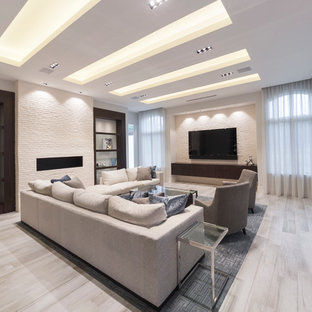 Large minimalist open concept porcelain tile and beige floor living room photo in Miami with white walls, no fireplace, a brick fireplace and a wall-mounted tv