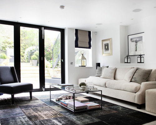 Example Of A Trendy Living Room Design In London With White Walls