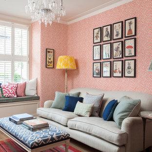 ロンドンのトラディショナルスタイルのおしゃれな独立型リビング (フォーマル、オレンジの壁、淡色無垢フローリング、ベージュの床) の写真