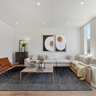 Example of a trendy formal and open concept light wood floor and beige floor living room design in San Francisco with white walls