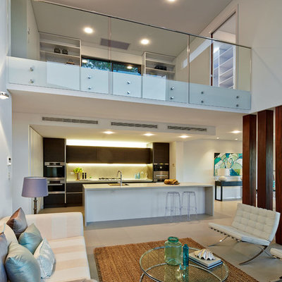 Large trendy open concept and formal living room photo in Sydney with white walls