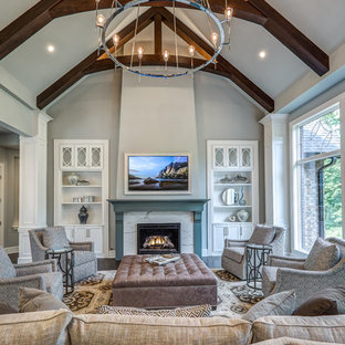 Large transitional formal and open concept dark wood floor and brown floor living room photo in Cincinnati with gray walls, a standard fireplace, a stone fireplace and a concealed tv