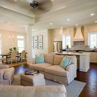 Cette photo montre un salon chic de taille moyenne et ouvert avec un sol en bois foncé, une salle de réception, un mur beige, aucune cheminée et aucun téléviseur.
