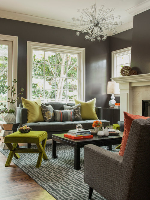 example of a transitional living room design with brown walls