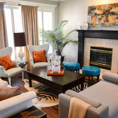 Living room - small eclectic formal and open concept medium tone wood floor living room idea in Dallas with gray walls, a standard fireplace, no tv and a tile fireplace