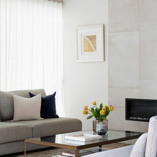 Mid-sized contemporary open concept living room in Sydney with white walls, travertine floors, a ribbon fireplace, a tile fireplace surround and white floor.