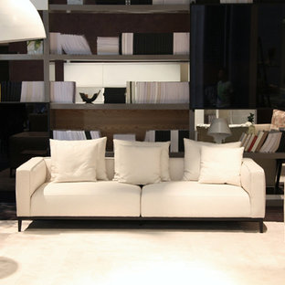 Large contemporary formal open plan living room in Toronto with brown walls, carpet, no fireplace, no tv and beige floors.