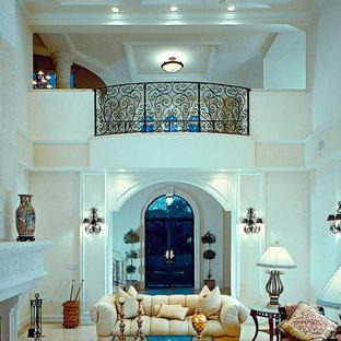 マイアミの中くらいの地中海スタイルのおしゃれなLDK (フォーマル、白い壁、磁器タイルの床、標準型暖炉、石材の暖炉まわり、テレビなし) の写真