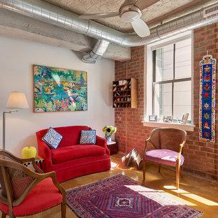 Imagen de salón para visitas bohemio, de tamaño medio, sin chimenea y televisor, con paredes blancas y suelo de cemento