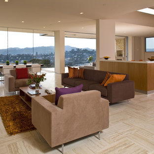 Living room - large modern open concept travertine floor living room idea in San Francisco with beige walls and no tv