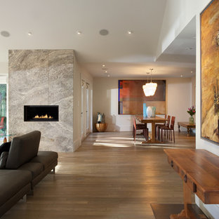Inspiration for a modern open concept living room remodel in Vancouver with a ribbon fireplace