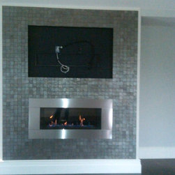 Gas direct vent fireplace - This is a Regency direct vent gas fireplace (HZ40). The homeowner will be placing their tv over it, in the recessed nook they have created.