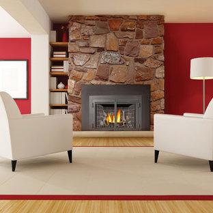 デンバーの中くらいのコンテンポラリースタイルのおしゃれなLDK (フォーマル、赤い壁、竹フローリング、標準型暖炉、石材の暖炉まわり、テレビなし) の写真