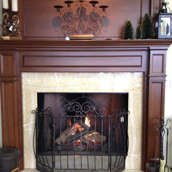 """Gas Fireplace with Wood Mantel - This is a 50"""" Lennox woodburning fireplace (Est50) with a Golden Blount gas log set. There is Honey Onxy as the stone and a Collinswood mantel and overmantel."""