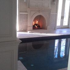 Mediterranean Indoor Fireplaces by KJB FIREPLACES