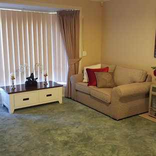 Elegant open concept carpeted and turquoise floor living room photo in Adelaide