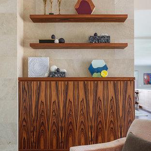 Immagine di un soggiorno minimalista di medie dimensioni e aperto con parquet scuro, camino classico, cornice del camino in pietra, nessuna TV e pavimento blu