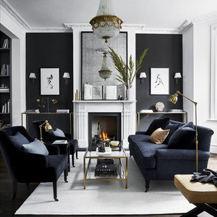 Esempio di un soggiorno classico aperto con sala formale, pareti bianche, parquet scuro, camino classico, nessuna TV e pavimento marrone